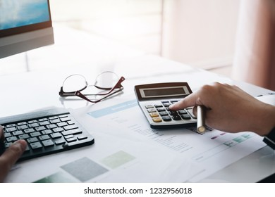 Businessman using calculator for calaulating finance, tax, accounting, statistics and analytic research concept
