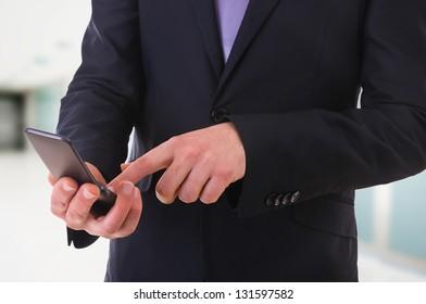 Businessman using cellphone.