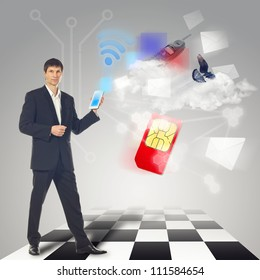 Businessman using communications device with touch screen with email, sms, cloud service and other communications symbol