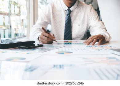 Businessman using computer to analyse the investment.