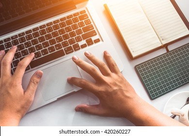 Businessman using computer with hands typing on a keyboard.