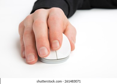 A Businessman is using a Computer Mouse on a white ground.