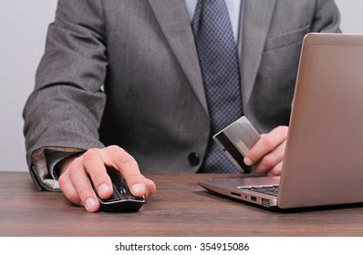 Businessman is using credit card for on line payment  close up