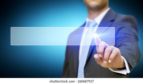 Businessman using digital interface with his fingers