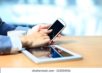 Businessman using digital tablet computer with modern mobile phone. New technologies for success workflow concept.