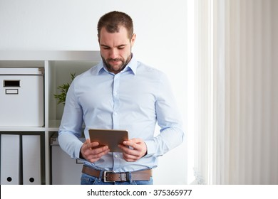 Businessman using digital tablet computer in the office