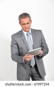 Businessman using electronic tab