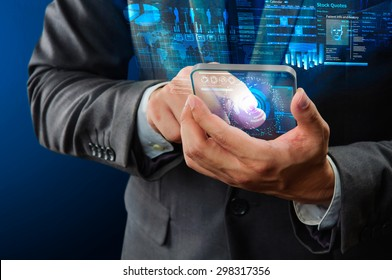businessman using futuristic transparency mobile device