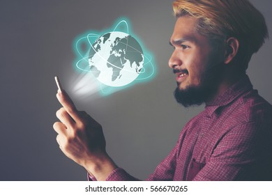 Businessman using global network and data exchanges with a mobile phone. Business technology concept.