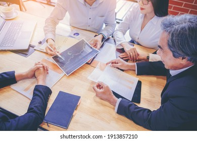 Businessman using hand gesture while explain business plan and discussion in the meeting. Selected focus.