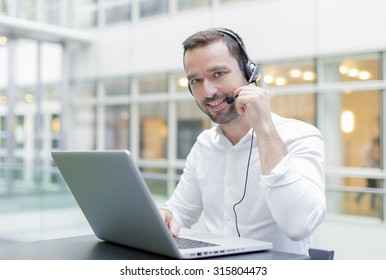 Businessman using head set