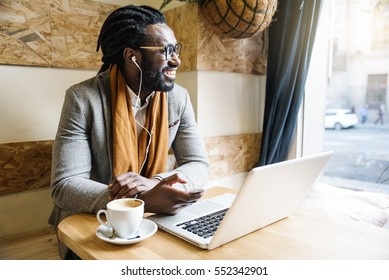 Businessman using his laptop in the Cofee Shop. Business Concept