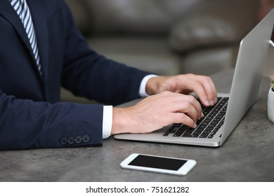 Businessman using his laptop while working in office