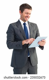 Businessman using his tablet pc on white background
