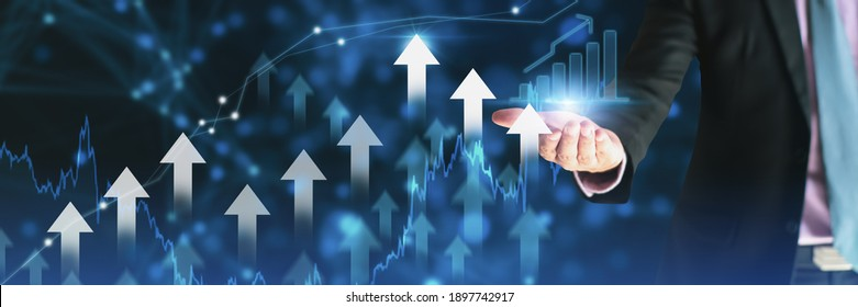 Businessman using holding symbol arrow up,stock graph and chart background,concept growth business and investment,Stock market and strategy for making market plan and stock market fluctuations