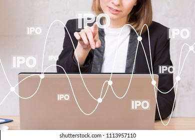 Businessman using innovative virtual touchscreen presses button ipo Initial Public Offering on chart