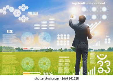 Businessman using interface to monitor agricultural products,and crop growth, and track the quality inspection of agriculture,concept,using technologies track productivity,satellite for agriculture.