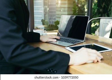 Businessman using laptop for business project, smart phone, touchpad, notbook