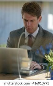 Businessman using laptop computer outdoors