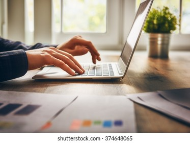businessman using laptop computer sitting working office.