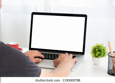 Businessman using laptop for new architectural project.