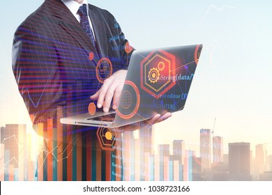 Businessman using laptop on abstract city background with HTML code. Computing and programming concept. Double exposure