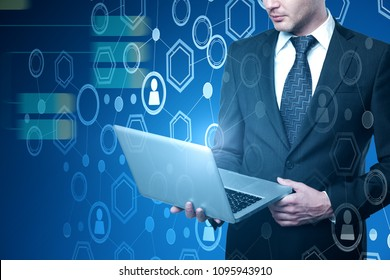Businessman using laptop on abstract digital business interface background. Analytics and technology concept. Double exposure
