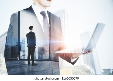 Businessman using laptop on abstract blurry office city background. Communication and occupation concept. Double exposure