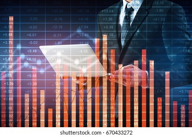 Businessman using laptop on abstract blue background with business chart. Accounting concept. Double exposure