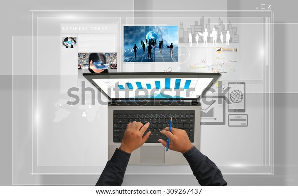 Businessman using laptop.Social media concept.