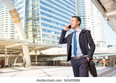 Businessman using a mobile.