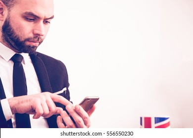 Businessman using mobile phone on the gray background
