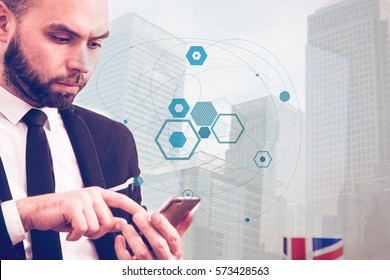 Businessman using mobile phone on technology background
