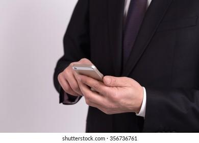 Businessman using mobile smart phone