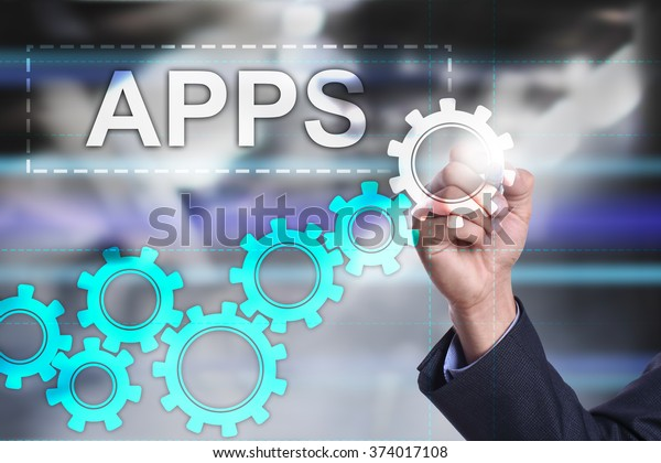 businessman using modern computer and drawing visual concept. APPS. mobile applications. personal applications development.