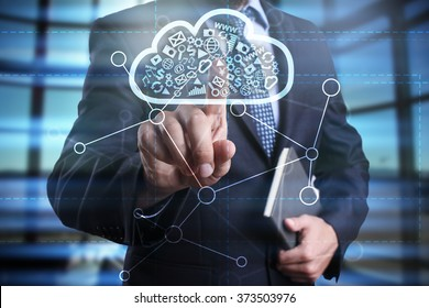 businessman using modern computer, pressing button on virtual screen. cloud technology and networking concept.