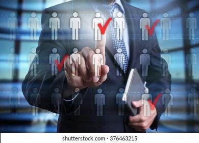 Businessman using modern computer, pressing human icon on virtual screen. Human resource, HR, team building, recruitment, headhunting, talent management.