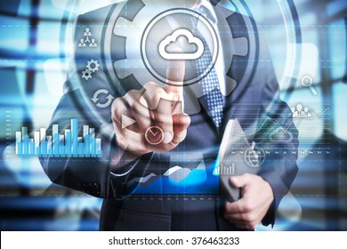 Businessman using modern computer, pressing button on virtual screen. cloud technology concept.?business, technology and internet concept.