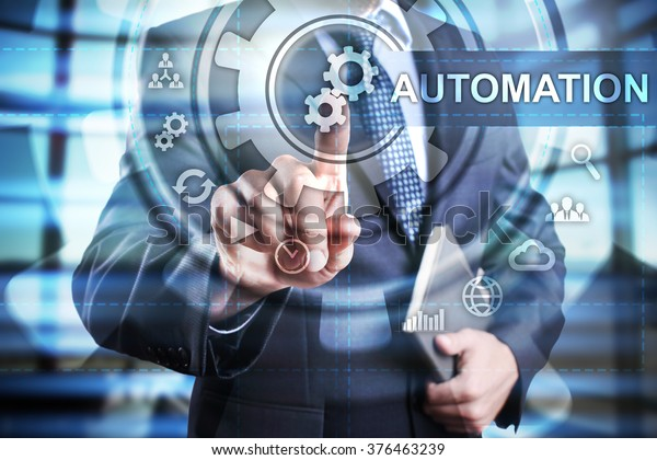 Businessman using modern computer, pressing automation icon on virtual screen. Business strategy. business, technology and internet concept.