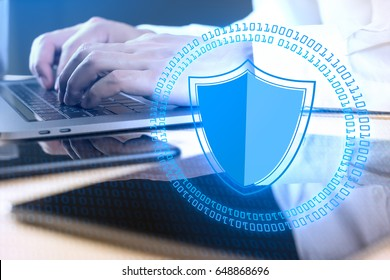 Businessman using modern laptop with Cyber Security Concept.