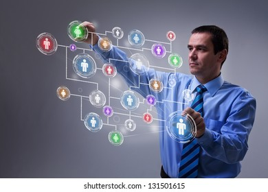 Businessman using modern social networking interface on virtual screen