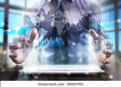 businessman using modern tablet computer with graphs, applications icons and map.  business technology and internet concept.