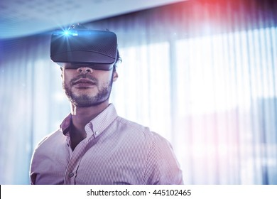 Businessman using an oculus in office