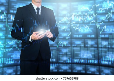 businessman using smart phone with digital electronic investing screen