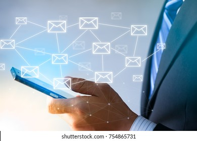 Businessman using smart phone with email,E-mail networking concept.