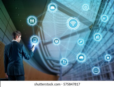 businessman using smart phone and internet of things concept, smart building, smart city, smart grid, information communication technology, abstract image visual