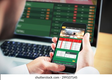292ab6531 Businessman using smartphone against gambling app screen