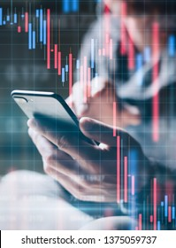 Businessman using smartphone and analysing financial data. Concept of a digital diagram, graph interface, virtual screen, technical price indicator, trading online, global market, broker at work