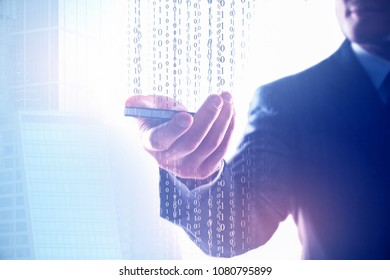 Businessman using smartphone with binary code on abstract city background. Computing and software concept. Double exposure