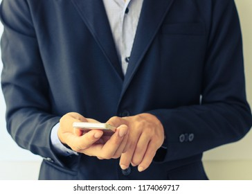Businessman using smartphone. Business and Technology concept.